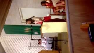 """Jessie singing """"On Eagles Wing"""" at graduation."""