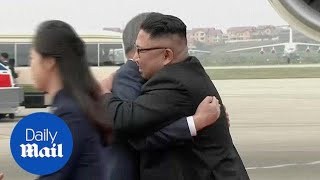 Moon and Kim Jong Un embrace at Pyongyang airport ahead of summit