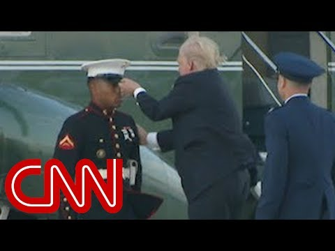 Trump stops to retrieve Marine's hat