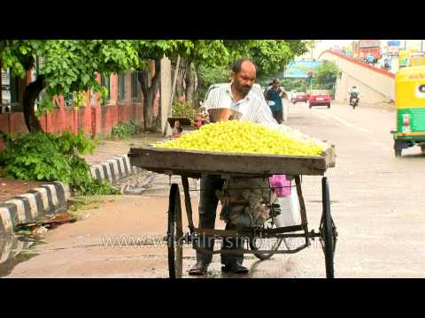 Vegetable seller selling lemons