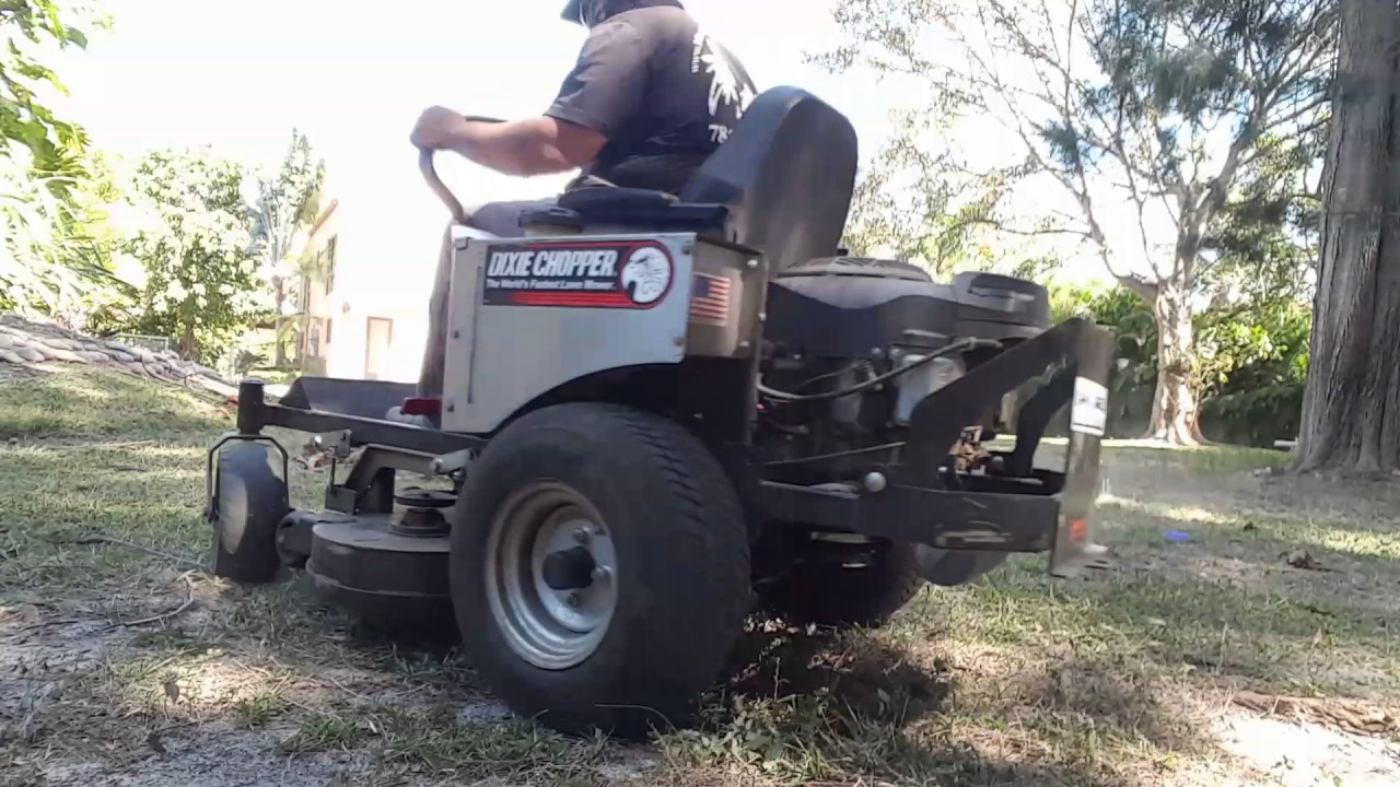 hight resolution of mulching up dry leaves on the grass with my dixie chopper