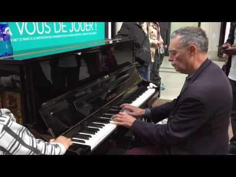 Senior Citizen Playing An Amazing Piece In A Public Piano in Paris