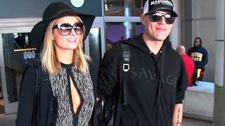 Paris Hilton And Chris Zylka Return To LA Holding Hands