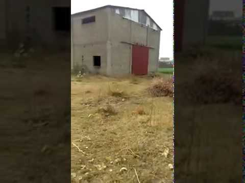 Factory Building in Gadoon in front of Chinese Steel Mill & Saif Textile Mill