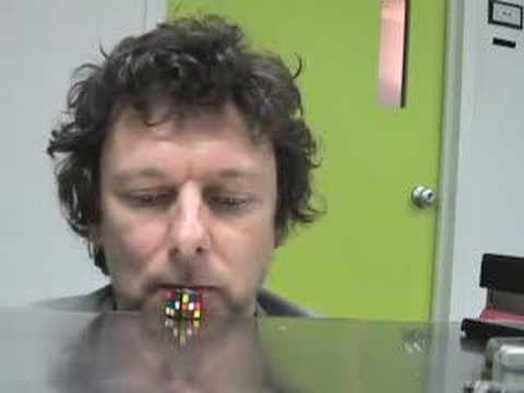 Michel Gondry Solves a Rubiks Cube with his Nose