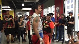 Manny Pacquiao hits the heavy bag in training for Horn