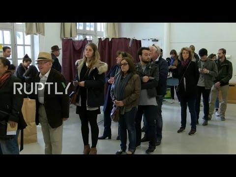 LIVE: Parisians queue up to cast their vote