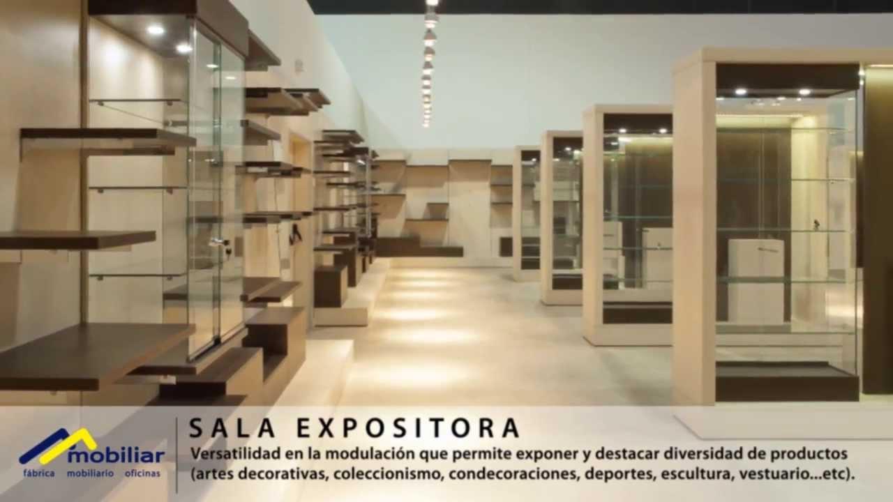 Sala expositora con estanterías modulares y vitrinas. - YouTube