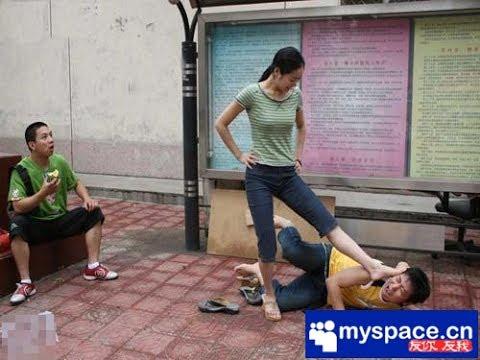 Woman Stepping On Man Chinese domesti...