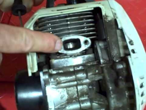 Small Engine Repair Cleaning Carbon Buildup On The