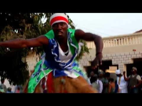 Stilt Dancer in The Gambia at Sierra Leone cultural wedding