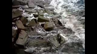 Swell waves breaking on Swanpool Beach, Cornwall.