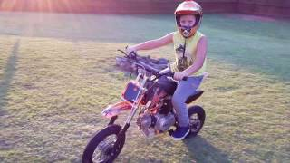 Service 110 DX back yard 9 year old riding wheelies and doughnuts Happy 4th