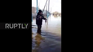Viral  Next stop   the hospital? Kazakh fisherman get creative during flood