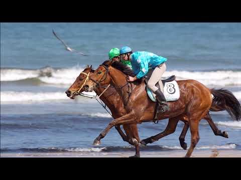 Carrera de caballos en la Playa de Santa Marina de Ribadesella