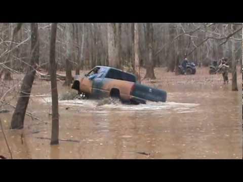 Huge mud trucks in deep slough
