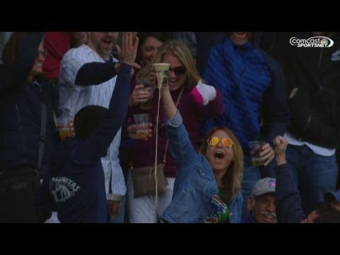 SD@CHC: Cubs fan catches foul ball with her beer