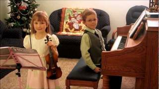 Jewelia and Caleb play Believe from the Polar Express