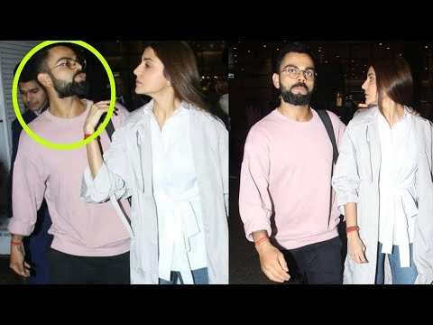 Aww ! Virat Kohli kissing Anushka Sharma at airport in public on returning from Vacation