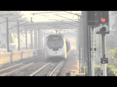 [HD] The MTR Northbound EMU SP1900 train at near Kau Lung Hang