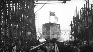 Large steel ship launched, without fanfare, at shipyard in United States.It flies...HD Stock Footage