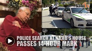 Police search at Najib's house passes 14-hour mark