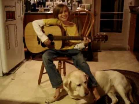 "Sawyer singing his newest original, ""Breaking Ice,"" featuring our lab, Sampson"