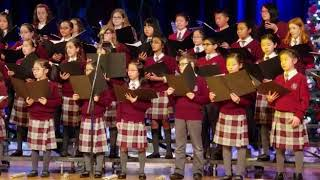 Om jai jagdish hare aarti sung by Canadian kids at a Christmas concert.