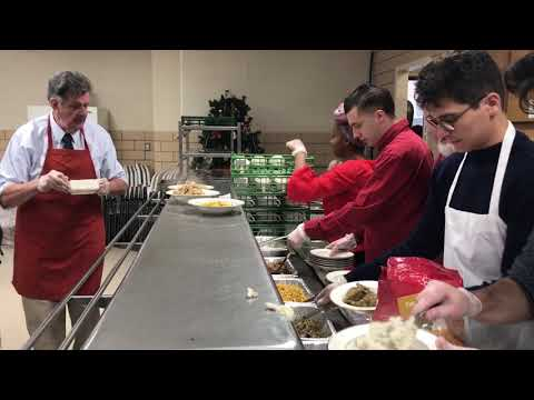 Volunteers Serve Christmas Dinner To 200 At Queens Church
