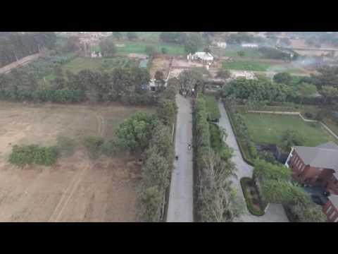 Aerial stock footage India Chattarpur farms Delhi