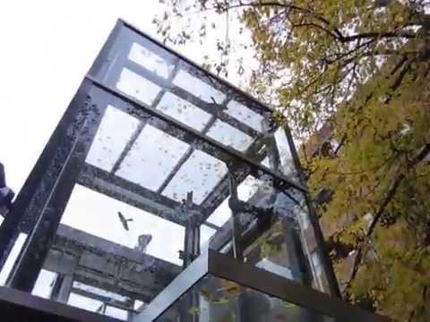 schmitt-+-sohn-hydraulic-glass-elevator-at-an-office-building-in-landshut