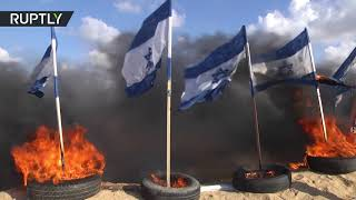 إحراق أعلام إسرائيل على حدود قطاع غزة