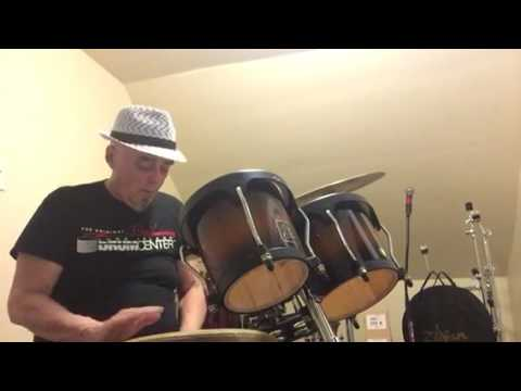 Larry Dominick plays hand percussion...