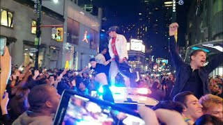Jumping on police and Swarming roads. Raptor fans go crazy on …