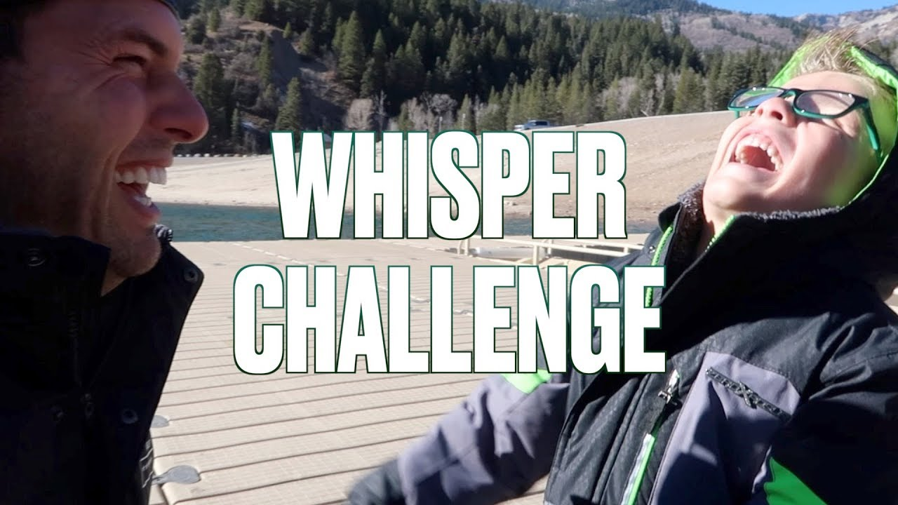 hilarious-and-adorable-father-son-whisper-challenge-on-a-frozen-lake-skipping-rocks-on-ice