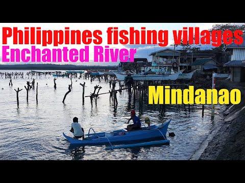 Philippines fishing village by bangka at the Enchanted River, Mindanao