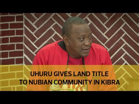Uhuru gives land title to Nubian Community in Kibra