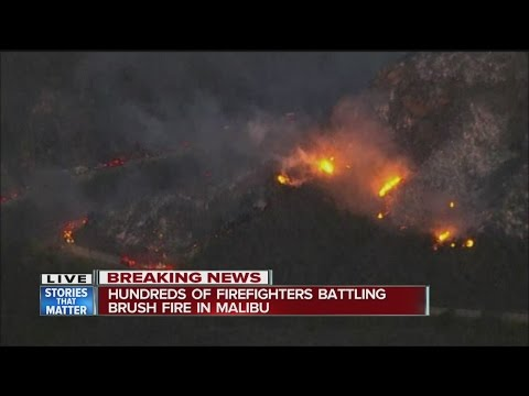 Brush fire rages in Malibu, 200 firefighters battle flames
