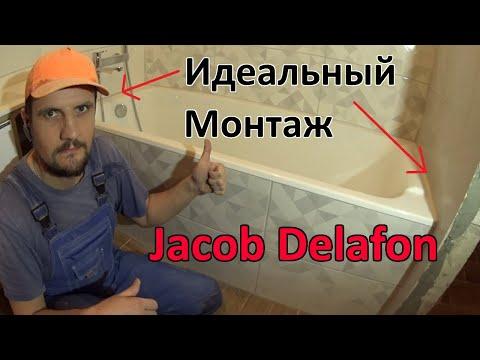 Идеальная установка чугунной ванны Jacob Delafon  под плитку с экраном из плитки и скрытым люком.