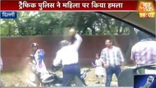 Delhi Traffic Cop Hits Woman With Bricks