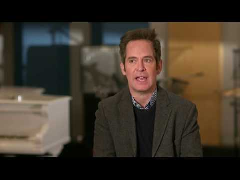 "BOHEMIAN RHAPSODY ""Jim Beach"" Tom Hollander Behind The Scenes Interview"