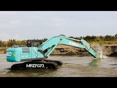 Kobelco SK200-10 Excavator Loading Dump Truck