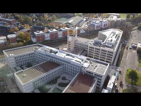 Drone footage of Cambridge Assessment's Triangle building in Cambridge, UK
