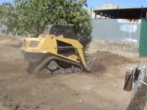 Bobcat pushing and moving dirt