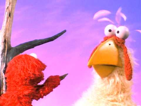 The Adventures of Elmo in Grouchland  Elmo runs away from the giant chicken 4:3