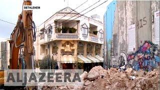 Banksy opens Walled Off Hotel in Bethlehem