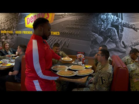 The New Day serve pancakes to troops at Denny