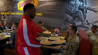 The New Day serve pancakes to troops at Denny's