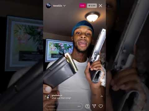 Toosii shows gun