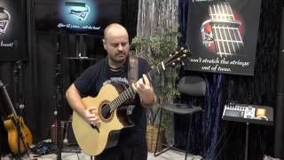 """Andy McKee plays """"Africa"""" at the Shubb Capos booth."""